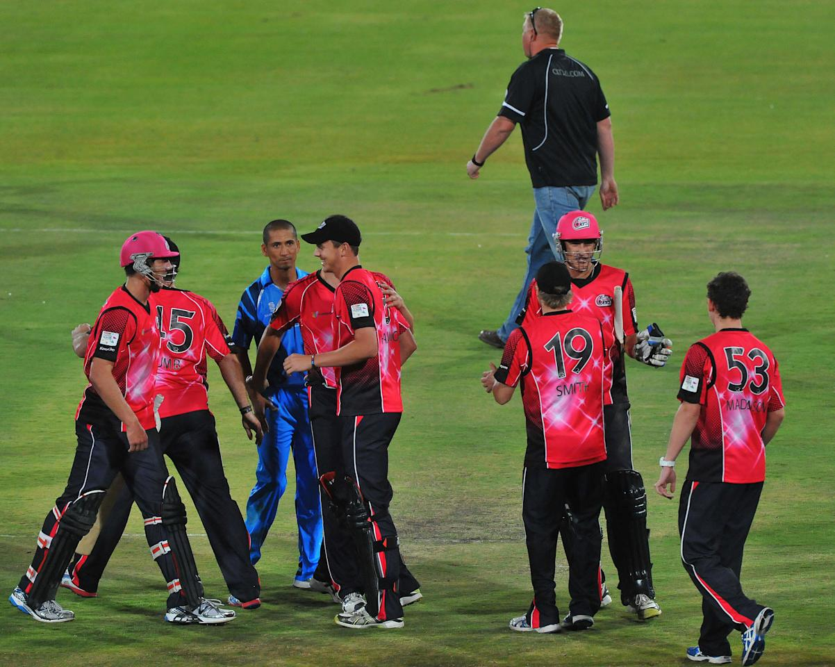 PRETORIA, SOUTH AFRICA - OCTOBER 26: (SOUTH AFRICA OUT) Sixers celebrate the win during the Karbonn Smart CLT20 Semi Final match between Nashua Titans and Sydney Sixers at SuperSport Park on October 26, 2012 in Pretoria, South Africa. (Photo by Duif du Toit/Gallo Images/Getty Images)