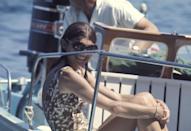 <p>Jackie O smiles onboard a boat off of Skorpios in Greece. </p>