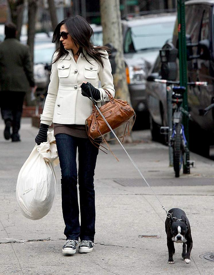 "Like many Manhattanites, Famke pairs her comfortable walking shoes with a luxurious bag and a sophisticated pea coat. MacFarlane/Ambler/<a href=""http://www.splashnewsonline.com"" target=""new"">Splash News</a> - December 5, 2007"