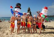 """<p>Christmas is a <a href=""""https://www.housebeautiful.com/lifestyle/g13938744/up-and-coming-travel-destinations/"""" rel=""""nofollow noopener"""" target=""""_blank"""" data-ylk=""""slk:summer holiday"""" class=""""link rapid-noclick-resp"""">summer holiday</a> down is Australia, which means fun in the sun. Folks often head to the beach and throw their dinner on the grill. Many towns also host large gatherings, where carols are sung by candlelight. </p>"""