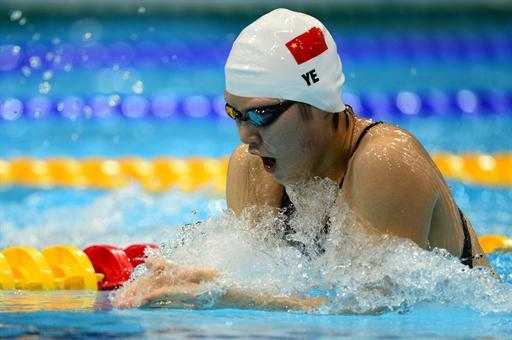 China's Ye Shiwen competes in the women's 200m individual medley final during the swimming event at the London 2012 Olympic Games on July 31, 2012 in London. AFP PHOTO / MARTIN BUREAU