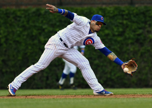 Chicago Cubs shortstop Javier Baez (9) catches a ball hit by Cincinnati Reds' Jose Peraza (9) during the second inning of a baseball game Sunday, May 26, 2019, in Chicago. (AP Photo/Matt Marton)