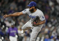 Los Angeles Dodgers relief pitcher Kenley Jansen works against the Colorado Rockies in the ninth inning of a baseball game Tuesday, Sept. 21, 2021, in Denver. (AP Photo/David Zalubowski)