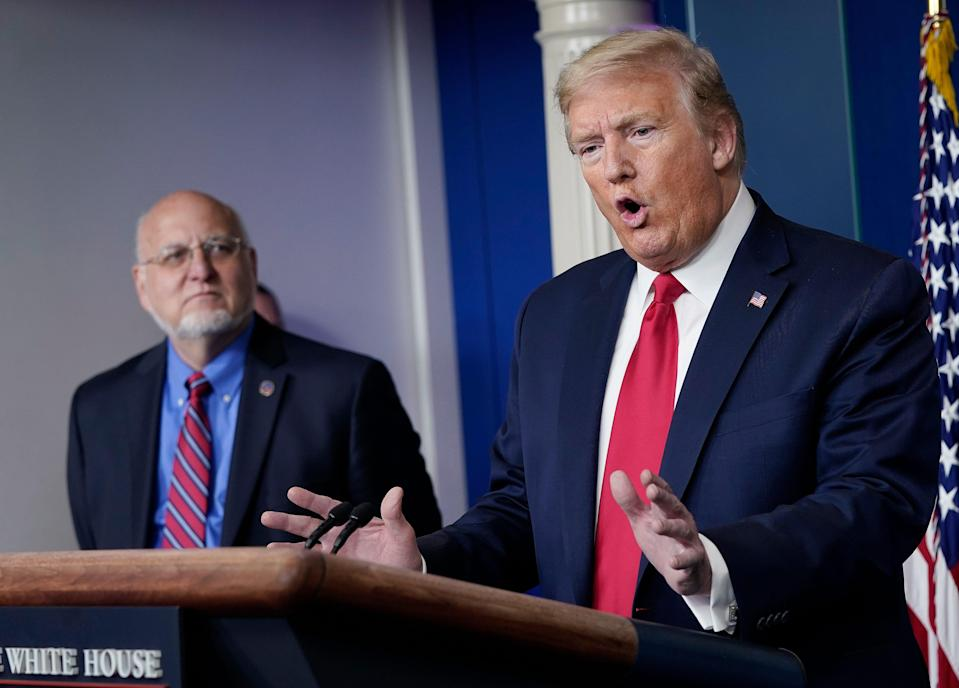 President Donald Trump speaks while flanked by Dr. Robert Redfield, Director of the Centers for Disease Control and Prevention, during the daily briefing of the coronavirus task force at the White House on April 22, 2020 in Washington, DC. Dr. Redfield,Êhas said that a potential second wave ofÊcoronavirus later this year could flare up again and coincide with flu season.