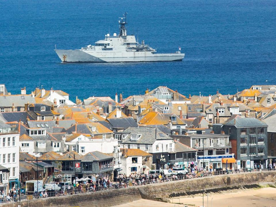HMS Tyne is seen in just off the coast at the G7 summit site in St Ives, Cornwall, June 8 2021. Leaders from around the world are expected in the seaside town later this week. (James Dadzitis / SWNS)