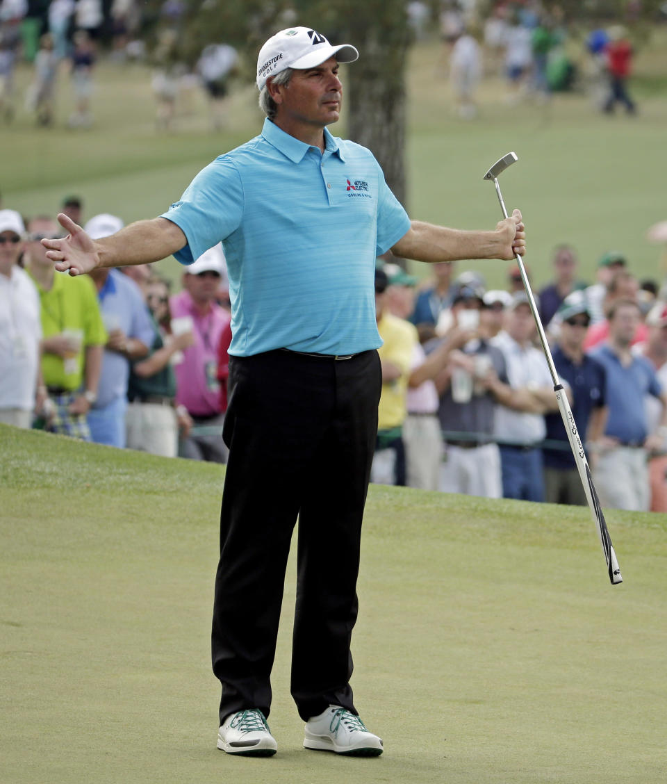 Fred Couples reacts after missing a birdie putt on the seventh green during the fourth round of the Masters golf tournament Sunday, April 13, 2014, in Augusta, Ga. (AP Photo/Chris Carlson)