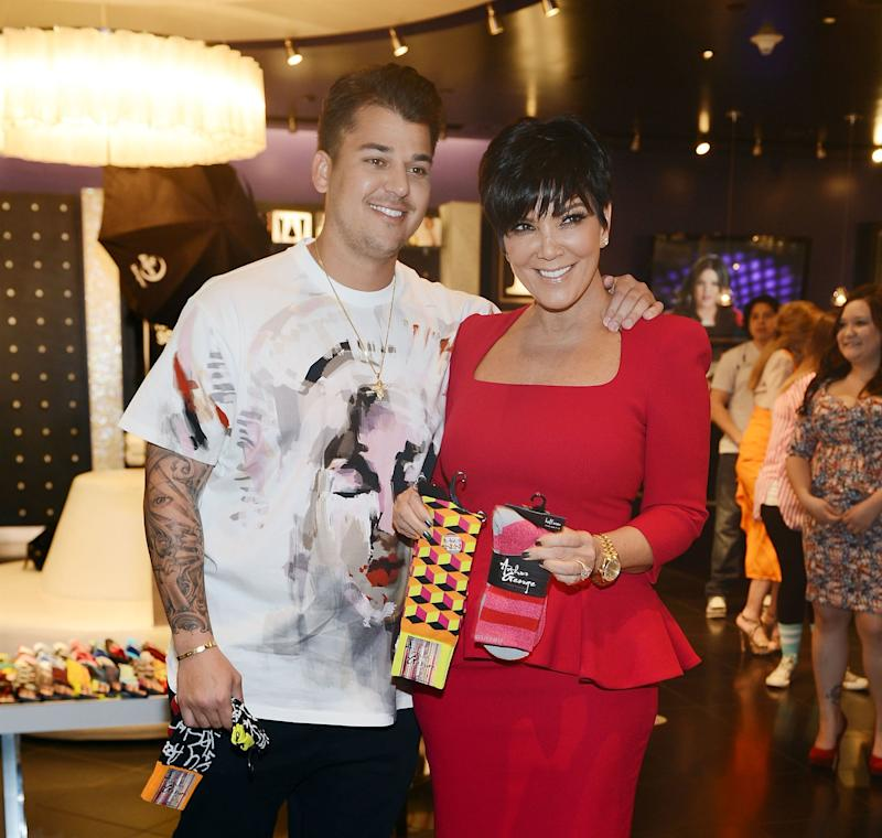 Rob Kardashian and Kris Jenner at Kardashian Khaos for the launch of Arthur George's street sock line in Las Vegas, March 2013.