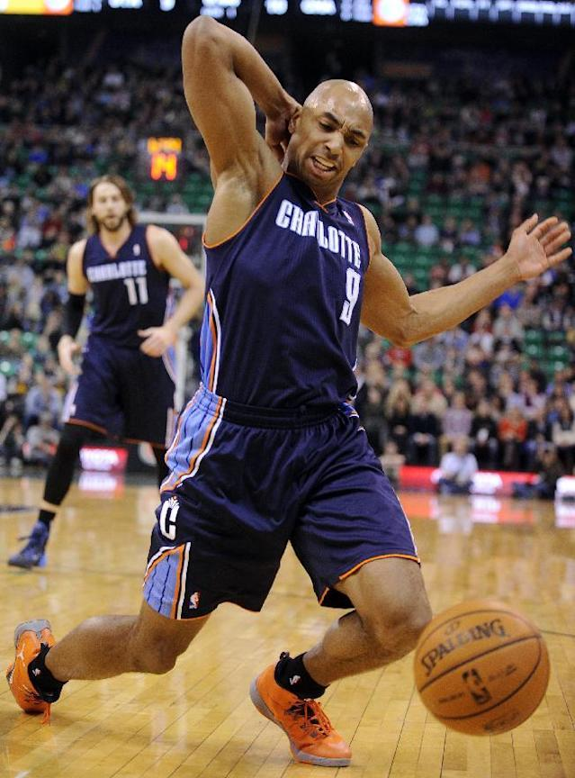 Charlotte Bobcats' Gerald Henderson (9) stumbles and loses the ball out of bounds in the first quarter of an NBA basketball game against the Utah Jazz, Monday, Dec. 30, 2013, in Salt Lake City. (AP Photo/Gene Sweeney Jr.)