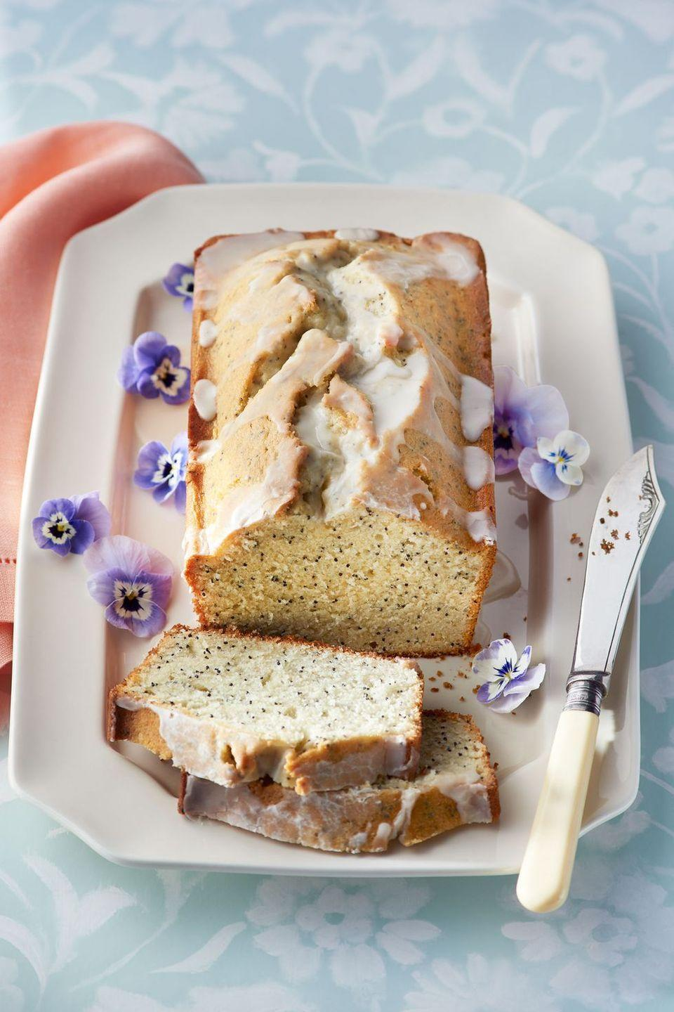 """<p>Serve this light and nutty loaf cake with a cup of hot tea for the day's grand finale.</p><p><em><a href=""""https://www.countryliving.com/food-drinks/recipes/a37725/almond-and-poppy-seed-loaf-cake-recipe/"""" rel=""""nofollow noopener"""" target=""""_blank"""" data-ylk=""""slk:Get the recipe from Country Living »"""" class=""""link rapid-noclick-resp"""">Get the recipe from Country Living »</a></em></p>"""
