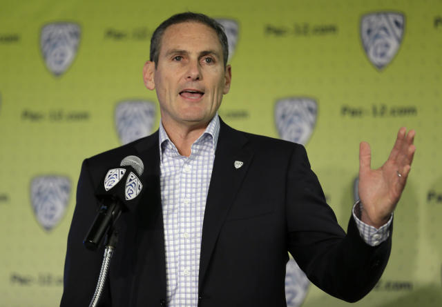 Pac-12 commissioner Larry Scott offered hints on some specific changes we could see in college basketball. (AP)