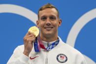 Caeleb Dressel, of United States, poses after winning the gold medal in the men's 100-meter butterfly final at the 2020 Summer Olympics, Saturday, July 31, 2021, in Tokyo, Japan. (AP Photo/Gregory Bull)