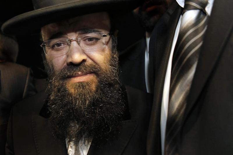 In a Sunday July 1, 2012 photo, Rabbi Yaakov Israel Ifargan, known as the 'X-Ray' rabbi for the belief he has the ability to diagnose patients by eyesight only, looks on during the annual gathering of the rabbi's followers and supporters in the town of Netivot, southern Israel. Over the past few decades, Ifargan and dozens of other rabbis have carefully positioned themselves at the fulcrum of Israeli power and influence. (AP Photo/Tsafrir Abayov)