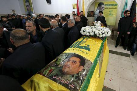 People offer their condolences near the coffin of Lebanese Hezbollah militant leader Samir Qantar during his funeral in Beirut's southern suburbs, Lebanon December 21, 2015. REUTERS/Jamal Saidi