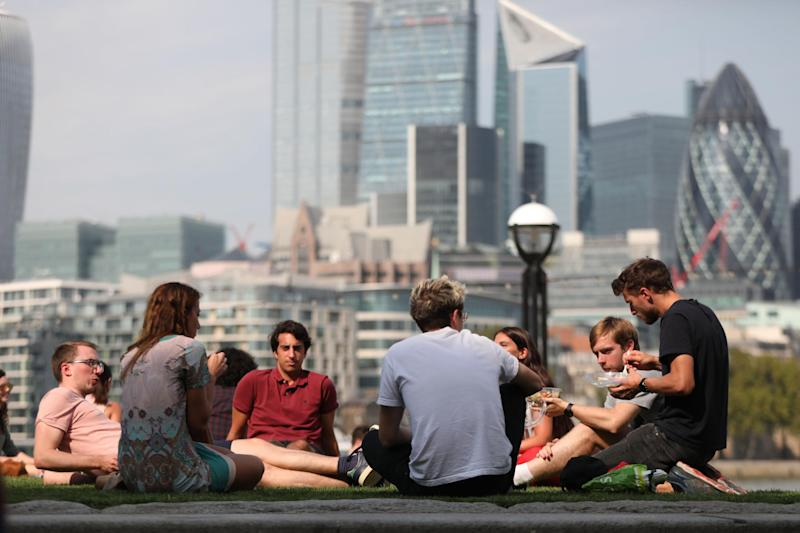 Brits enjoy the autumn sunshine at The Scoop, More London next to City Hall: PA