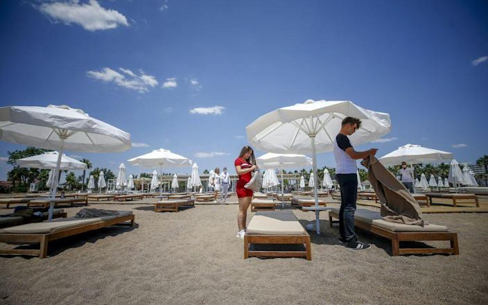 Loungers are carefully arranged at a beach in Antalya, Turkey