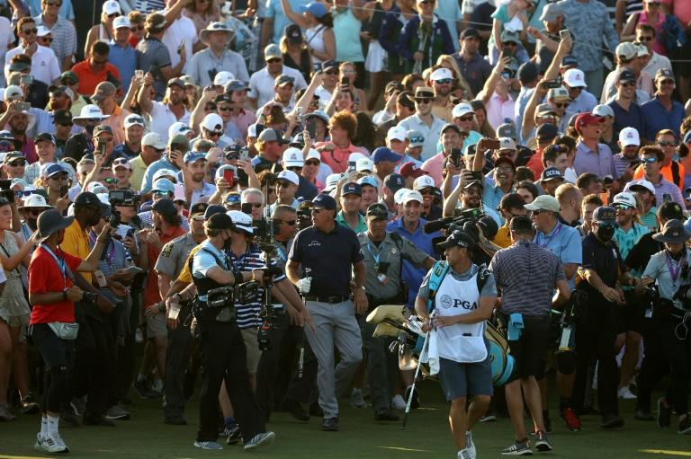 Phil Mickelson is cheered on by fans as he walks to the 18th green on the way to victory in the 2021 PGA Championship at Kiawah Island, South Carolina