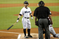 Miami Marlins' Jon Berti, left, argues a call with home plate umpire Hunter Wendelstedt after striking out during the first inning of a baseball game against the Cincinnati Reds, Monday, Aug. 26, 2019, in Miami. (AP Photo/Wilfredo Lee)