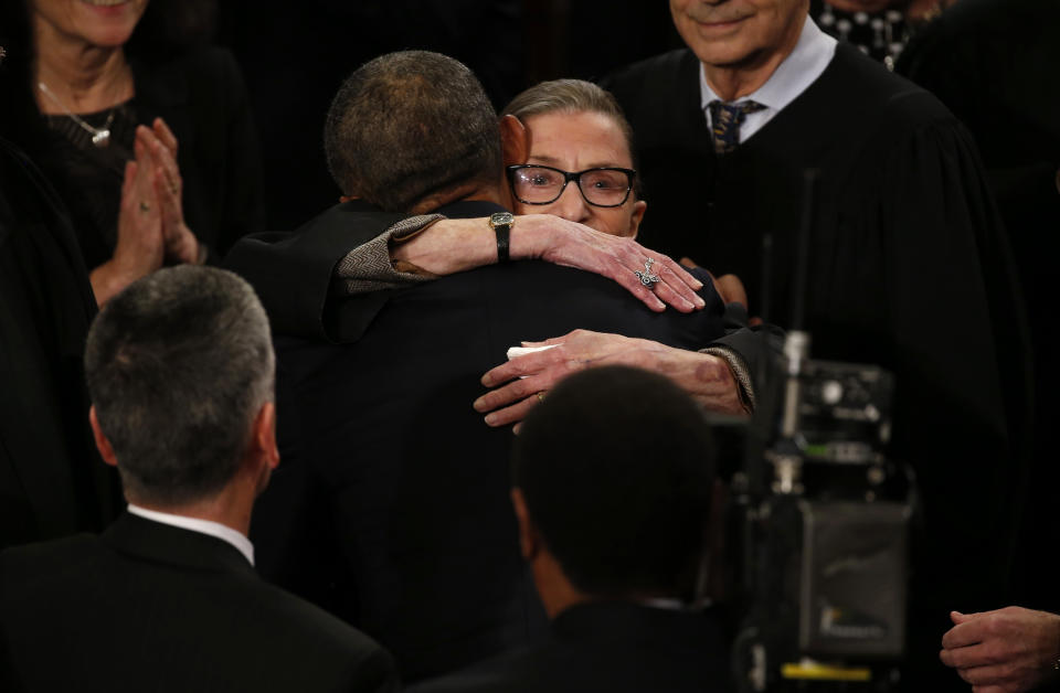 President Barack Obama hugs Ginsburg as the president arrives to deliver his State of the Union address. (Photo: Jonathan Ernst/Reuters)