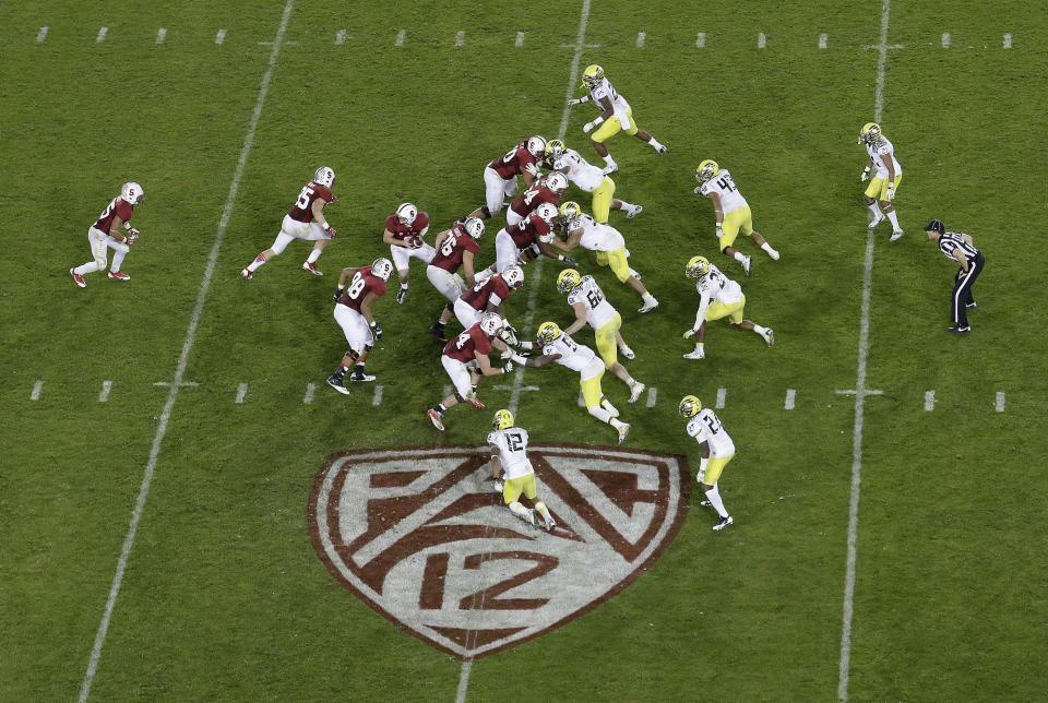 Stanford QB Kevin Hogan (8) drops back against Oregon over Pac-12 logo at Stanford Stadium on Nov. 7, 2013. (AP)
