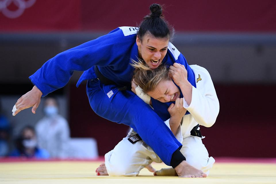 <p>France's Margaux Pinot (white) and Greece's Elisavet Teltsidou compete in the judo women's -70kg elimination round bout during the Tokyo 2020 Olympic Games at the Nippon Budokan in Tokyo on July 28, 2021. (Photo by Franck FIFE / AFP)</p>