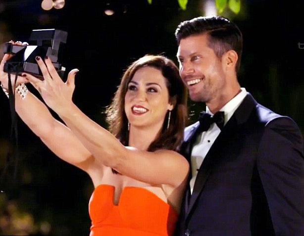 A photo of Jacinda Gugliemino and Sam Wood taking a polaroid selfie on The Bachelor Australia in 2015.
