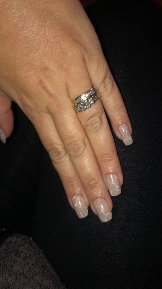 Woman's at-home isolation manicure with Kmart fake nails