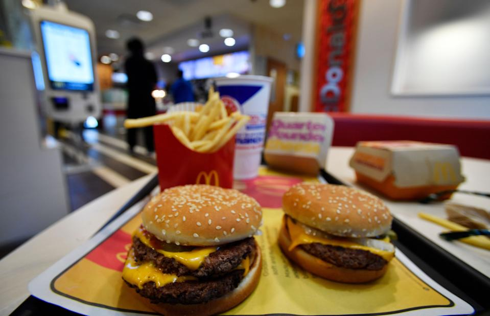 A McDonald's Quarter Pounder, right and a Double Quarter Pound burger is shown with the new fresh beef, Tuesday, March 6, 2018, in Atlanta.  (Photo: Mike Stewart/AP)