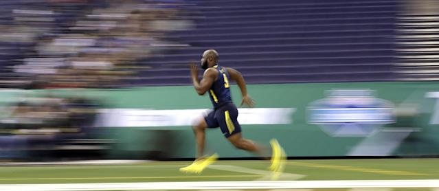 Here's Leonard Fournette running fast at the NFL combine at 240 pounds. He weighed 228 on Wednesday. (AP)