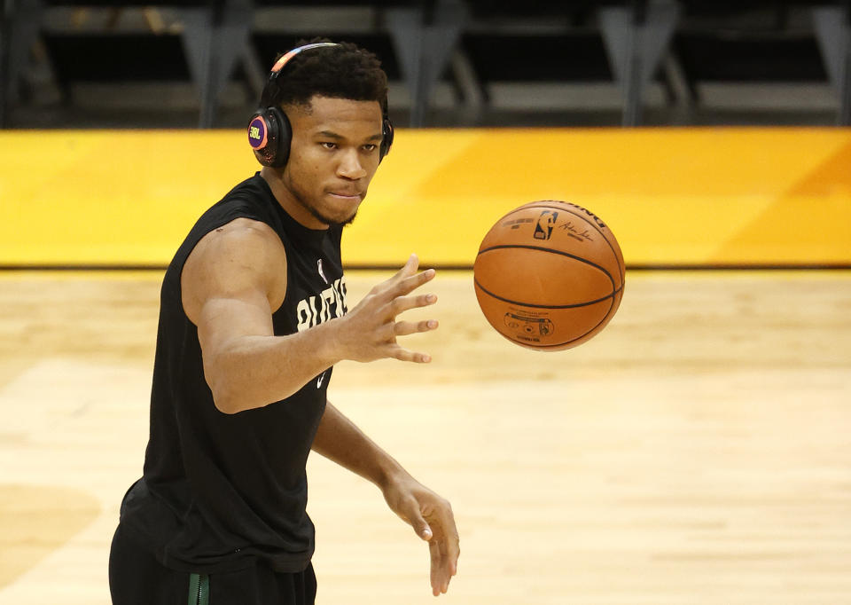 PHOENIX, ARIZONA - JULY 06: Giannis Antetokounmpo #34 of the Milwaukee Bucks warms up before Game One of the NBA Finals against the Phoenix Suns at Phoenix Suns Arena on July 06, 2021 in Phoenix, Arizona. NOTE TO USER: User expressly acknowledges and agrees that, by downloading and or using this photograph, User is consenting to the terms and conditions of the Getty Images License Agreement. (Photo by Christian Petersen/Getty Images)