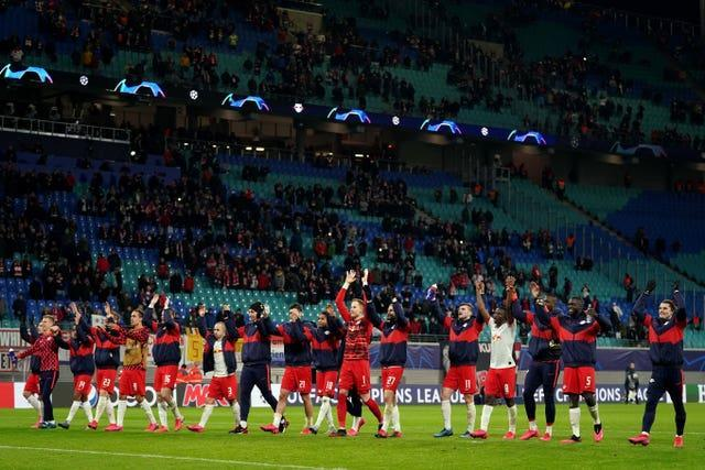RB Leipzig players celebrate at the end of a game