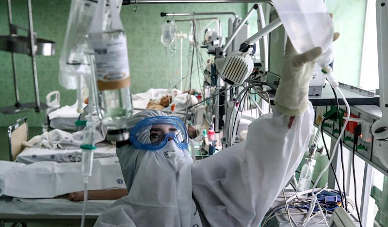 A nurse at an intensive care unit of the COVID-19 treatment facility in Russia, where confirmed and suspected cases are treated. Source: Getty