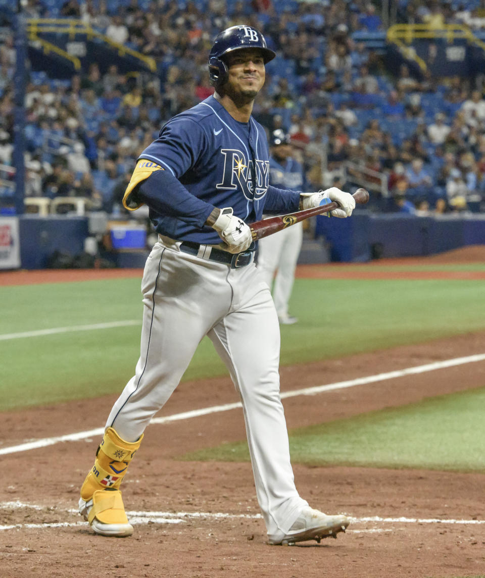 Tampa Bay Rays' Wander Franco smiles toward the dugout after earning a walk against Miami Marlins reliever Zach Thompson during the sixth inning of a baseball game Friday, Sept. 24, 2021, in St. Petersburg, Fla. Franco extended his on-base streak to 40 games. (AP Photo/Steve Nesius)