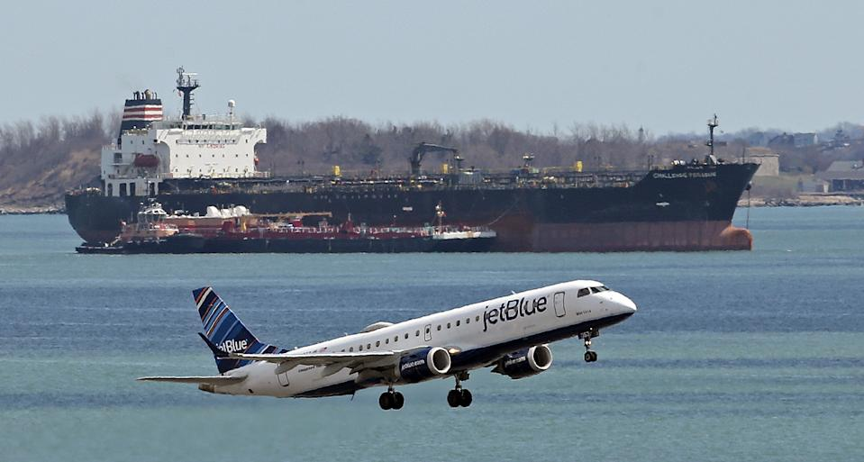 EAST BOSTON, MA. - APRIL 7: A JetBlue flight takes off at Logan Airport, less people are flying during the COVID-19 pandemic on April 7, 2020 in East Boston, Massachusetts. (Staff Photo By Matt Stone/MediaNews Group/Boston Herald)