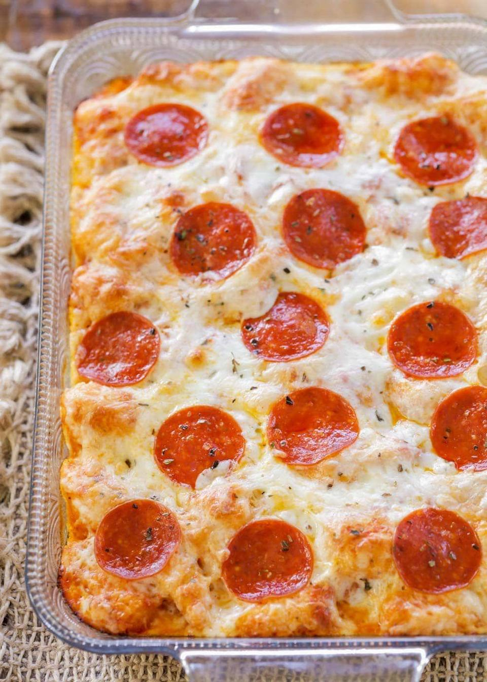 """<p>Turns out pizza <em>can</em> get better. Pre-made biscuit dough is the foundation of this supremely cheesy dish. You won't even question taking extra helpings.</p><p><strong>Get the recipe at <a href=""""https://lilluna.com/pizza-casserole/"""" rel=""""nofollow noopener"""" target=""""_blank"""" data-ylk=""""slk:Lil' Luna"""" class=""""link rapid-noclick-resp"""">Lil' Luna</a>.</strong> </p>"""