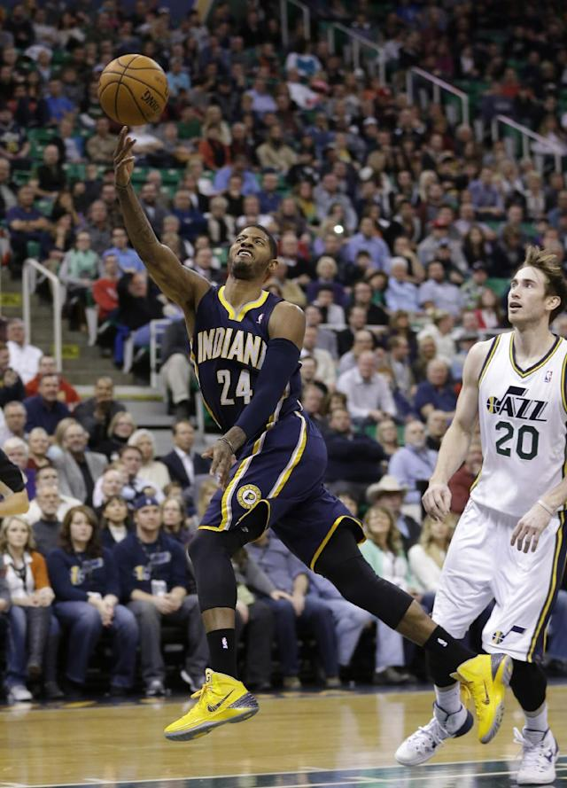 Indiana Pacers' Paul George (24) shoots the ball as Utah Jazz's Gordon Hayward (20) looks on in the second quarter during an NBA basketball game Wednesday, Dec. 4, 2013, in Salt Lake City. (AP Photo/Rick Bowmer)