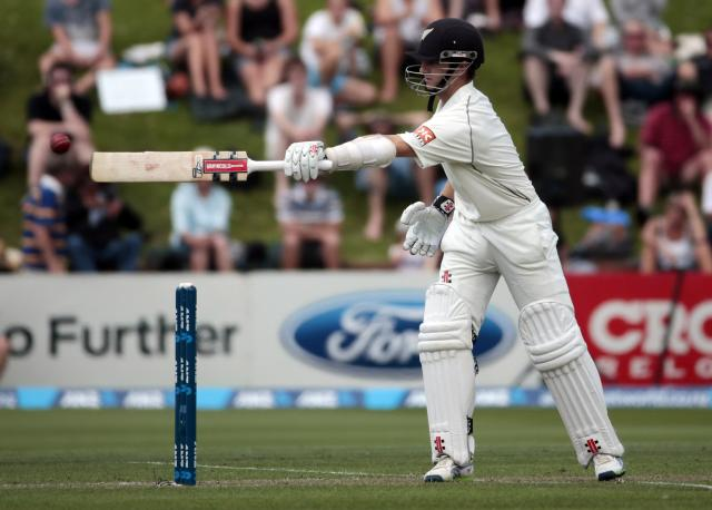 New Zealand's Kane Williamson keeps the ball away from his wicket during day one of the second international test cricket match against India at the Basin Reserve in Wellington, February 14, 2014. REUTERS/Anthony Phelps (NEW ZEALAND - Tags: SPORT CRICKET)