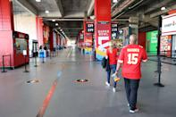 Fans walk through the concourse before Super Bowl LV between the Tampa Bay Buccaneers and the Kansas City Chiefs at Raymond James Stadium on February 07, 2021 in Tampa, Florida. (Photo by Patrick Smith/Getty Images)