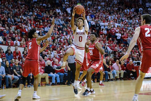 """Indiana guard <a class=""""link rapid-noclick-resp"""" href=""""/ncaab/players/148444/"""" data-ylk=""""slk:Romeo Langford"""">Romeo Langford</a> (0) shoots in front of Wisconsin guard <a class=""""link rapid-noclick-resp"""" href=""""/ncaab/players/131281/"""" data-ylk=""""slk:Khalil Iverson"""">Khalil Iverson</a> (21) during the second half. Indiana won 75-73 in double overtime. (AP)"""