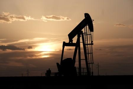 Oil pump jacks work at sunset near Midland
