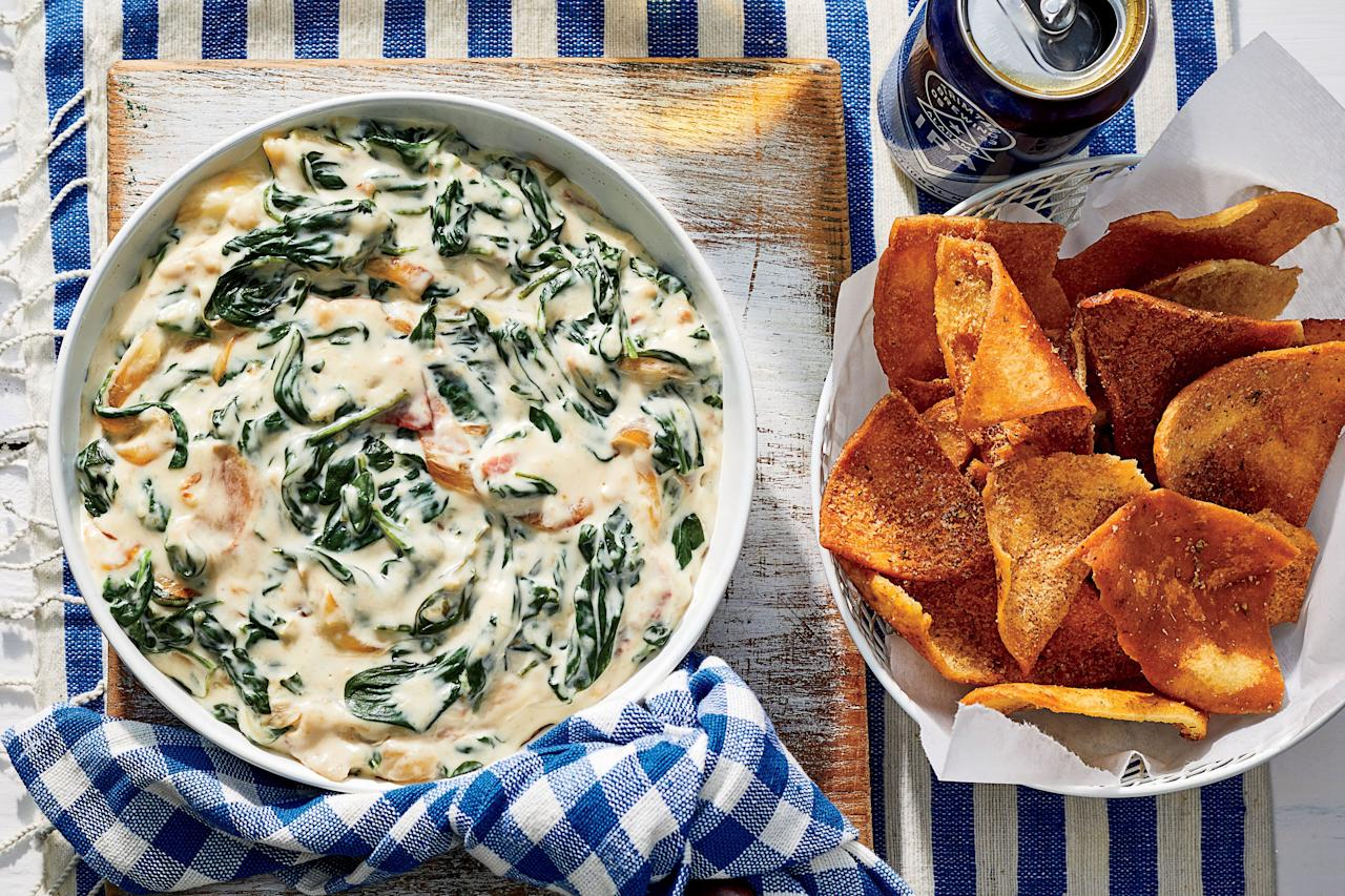 "<p><b>Recipe: <a href=""https://www.southernliving.com/recipes/warm-spinach-sweet-onion-dip-country-ham-recipe"">Warm Spinach-Sweet Onion Dip with Country Ham</a></b></p> <p>This creamy dip will warm up all your guests on a chilly Thanksgiving afternoon.</p>"