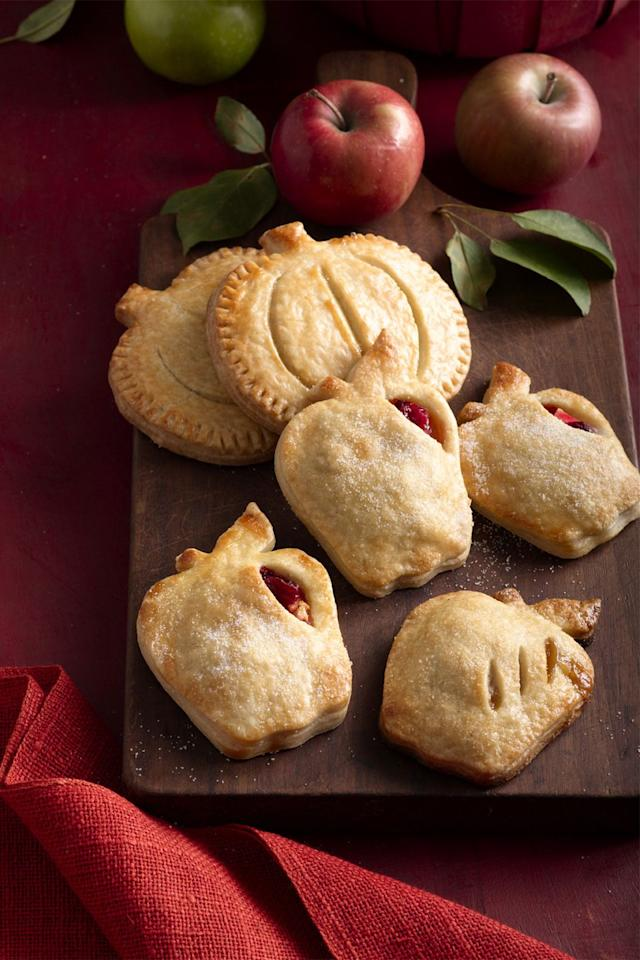 "<p>These mini apple and cranberry pies are sure to put a smile on everyone's face this season.</p><p><strong><a rel=""nofollow"" href=""https://www.womansday.com/food-recipes/food-drinks/recipes/a60186/apple-cranberry-hand-pies/"">Get the recipe</a>.</strong><br></p>"