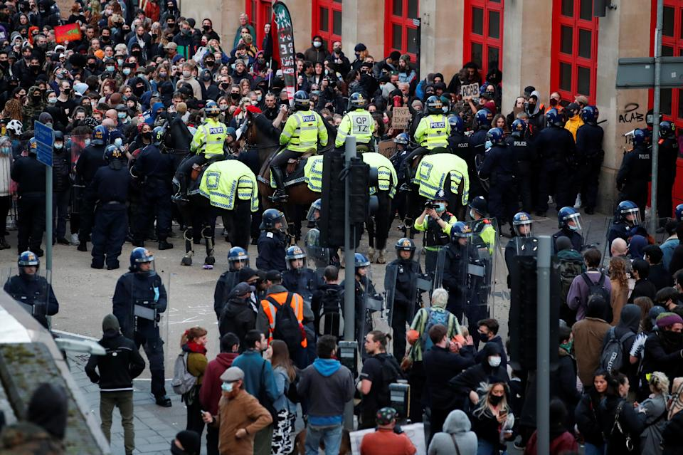 <p>Police officers form two lines to control the crowd during a protest against a new proposed policing bill, in Bristol, Britain, March 21, 2021. REUTERS/Peter Cziborra</p>