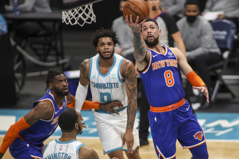 New York Knicks guard Austin Rivers (8) drives to the basket against the Charlotte Hornets in the first quarter of an NBA basketball game in Charlotte, N.C., Monday, Jan. 11, 2021. (AP Photo/Nell Redmond)