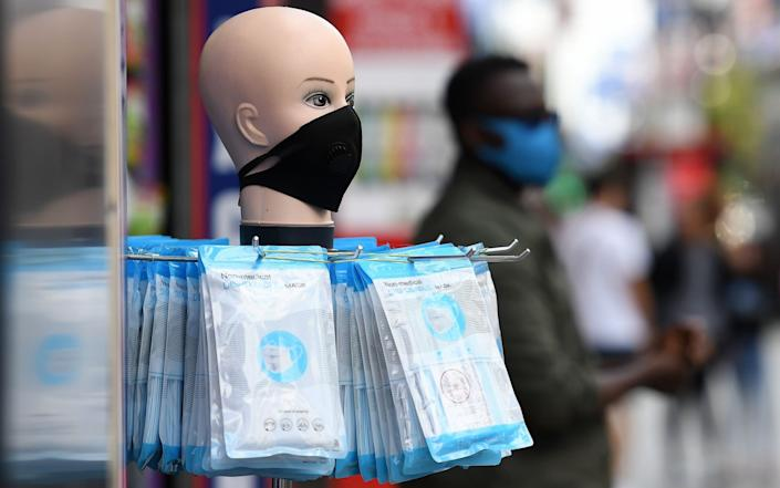 Disposable masks being sold at a store on Oxford Street in London - ANDY RAIN/EPA-EFE/Shutterstock