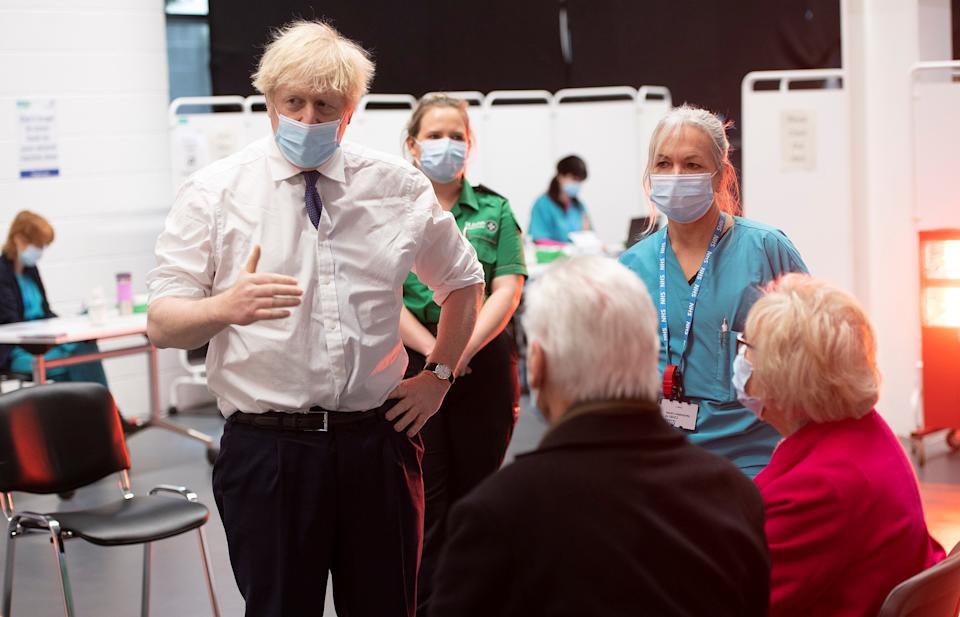 Britain's Prime Minister Boris Johnson visits at a COVID-19 vaccination centre at Ashton Stadium in Bristol, Britain January 11, 2021. Eddie Mulholland/Pool via REUTERS