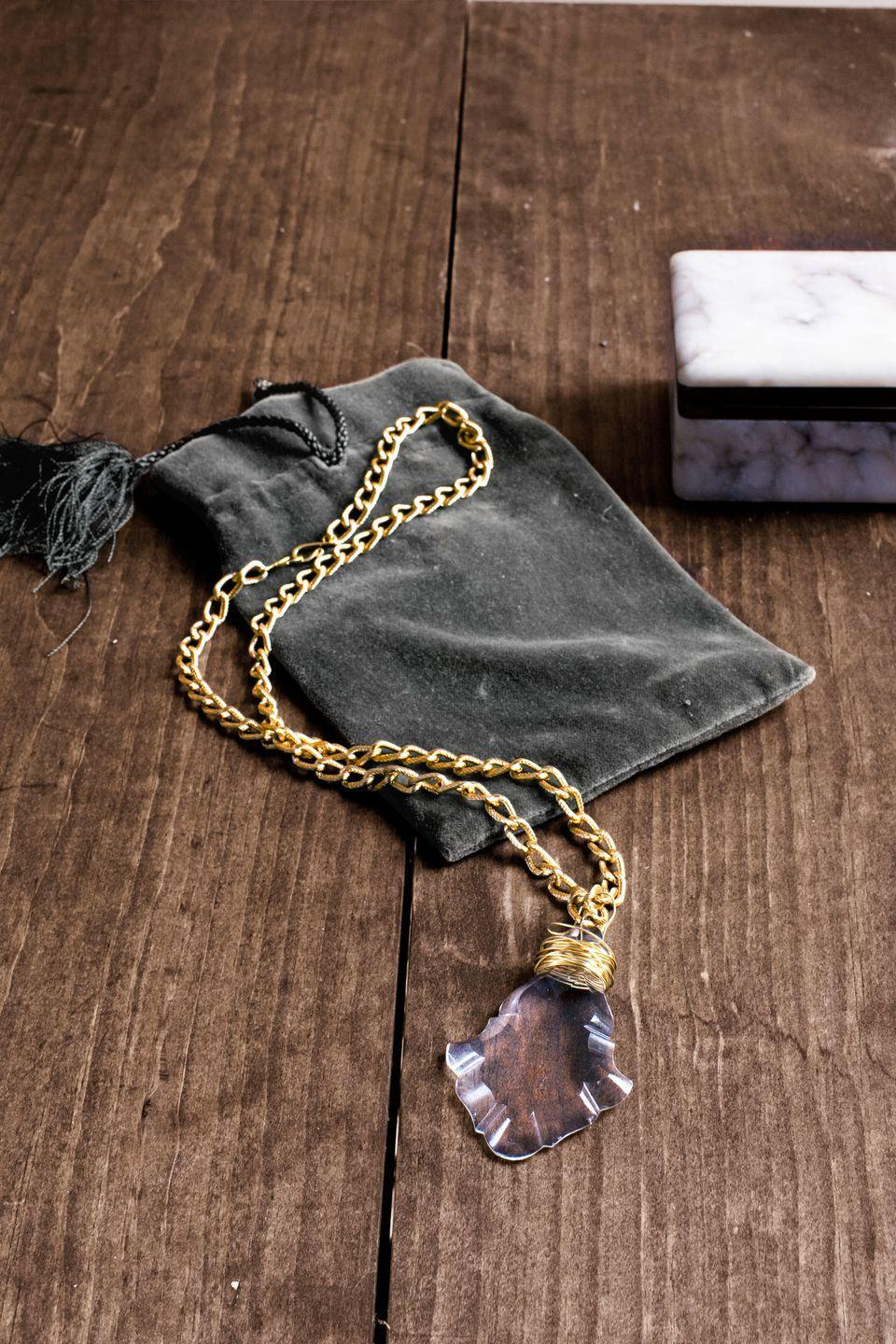 """<p>A dime a dozen at flea markets and antiques shops, cast-off prisms make for stunning pendants<em>.</em> First, use pliers to remove any existing wiring. Then tightly wrap <a href=""""https://www.amazon.com/Tarnish-Resistant-Craft-Wire-Gauge/dp/B003N0PFNG?tag=syn-yahoo-20&ascsubtag=%5Bartid%7C10050.g.645%5Bsrc%7Cyahoo-us"""" rel=""""nofollow noopener"""" target=""""_blank"""" data-ylk=""""slk:22-gauge gold craft wire"""" class=""""link rapid-noclick-resp"""">22-gauge gold craft wire</a> around the top of the prism, as shown below. Form a wire loop for your necklace chain; then, using pliers, cut the wire two inches past the loop before securing its end inside the wrapped wire. String a length of <a href=""""https://go.redirectingat.com?id=74968X1596630&url=https%3A%2F%2Fwww.etsy.com%2Flisting%2F152318849%2F32ft-10m-of-gold-tone-extension-chain&sref=https%3A%2F%2Fwww.countryliving.com%2Fdiy-crafts%2Ftips%2Fg645%2Fcrafty-christmas-presents-ideas%2F"""" rel=""""nofollow noopener"""" target=""""_blank"""" data-ylk=""""slk:gold-plated chain"""" class=""""link rapid-noclick-resp"""">gold-plated chain</a> through the wire loop. Attach a <a href=""""https://www.amazon.com/dp/B002TGYSZQ/ref=asc_df_B002TGYSZQ5093960/?tag=syn-yahoo-20&ascsubtag=%5Bartid%7C10050.g.645%5Bsrc%7Cyahoo-us"""" rel=""""nofollow noopener"""" target=""""_blank"""" data-ylk=""""slk:gold S hook"""" class=""""link rapid-noclick-resp"""">gold S hook</a> to each end of the chain. For a fanciful finish, present the necklace inside a <a href=""""https://www.amazon.com/s/ref=nb_sb_noss_2?url=search-alias%3Daps&field-keywords=velvet+pouch&tag=syn-yahoo-20&ascsubtag=%5Bartid%7C10050.g.645%5Bsrc%7Cyahoo-us"""" rel=""""nofollow noopener"""" target=""""_blank"""" data-ylk=""""slk:velvet pouch"""" class=""""link rapid-noclick-resp"""">velvet pouch</a>.</p><p><strong><a class=""""link rapid-noclick-resp"""" href=""""https://www.amazon.com/Tarnish-Resistant-Craft-Wire-Gauge/dp/B003N0PFNG?tag=syn-yahoo-20&ascsubtag=%5Bartid%7C10050.g.645%5Bsrc%7Cyahoo-us"""" rel=""""nofollow noopener"""" target=""""_blank"""" data-ylk=""""slk:SHOP CRAFT WIRE"""">SHOP CRAFT WIRE</a"""