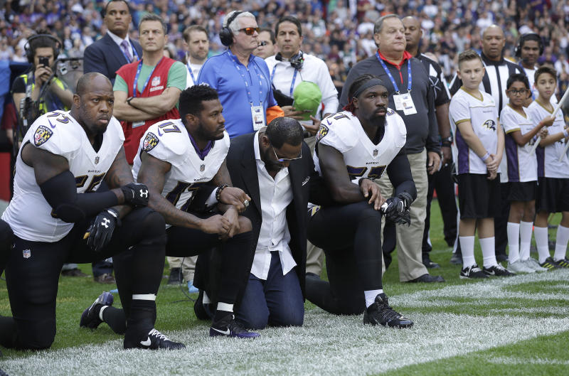 Baltimore Ravens outside linebacker Terrell Suggs, from left, Mike Wallace, former player Ray Lewis and inside linebacker C.J. Mosley kneel down during the playing of the U.S. national anthem. (AP)
