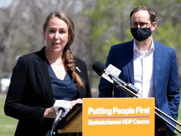 Aleana Young, the Opposition NDP's critic for SaskPower, and NDP Leader Ryan Meili are shown here in a May 2021 file photo. On Tuesday, they called for the provincial government to give families and businesses who missed bill payments during the last few months a chance to catch up without penalty. (Bryan Eneas/CBC - image credit)