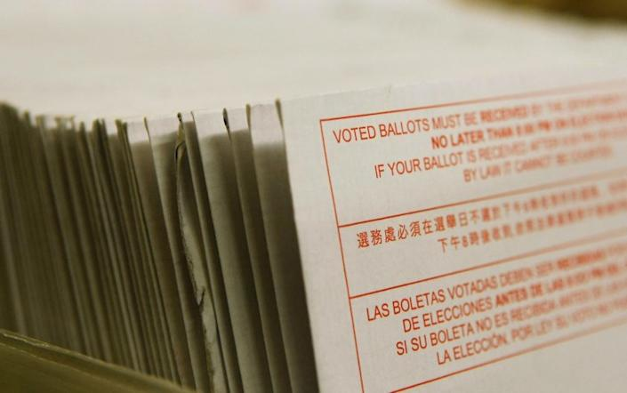 "A stack of California vote-by-mail ballots in 2008. <span class=""copyright"">(Justin Sullivan / Getty Images)</span>"