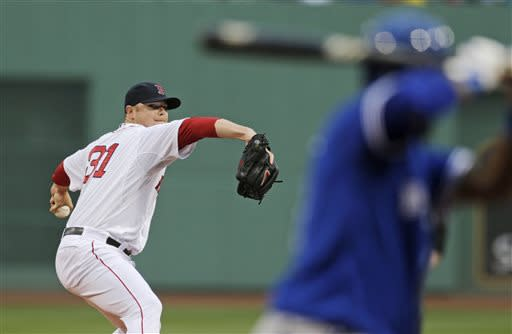 Boston Red Sox starting pitcher Jon Lester delivers to a Toronto Blue Jays batter during the first inning of a baseball game at Fenway Park, Thursday, June 27, 2013, in Boston. (AP Photo/Charles Krupa)